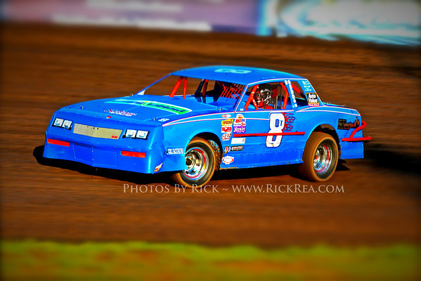 #8T Doug VanMill Street Stock Race Car Driver from Bagley MN rocketing his beautiful bright Blue hot rod around The Legendary Bullring River Cities Speedway in Grand Forks ND